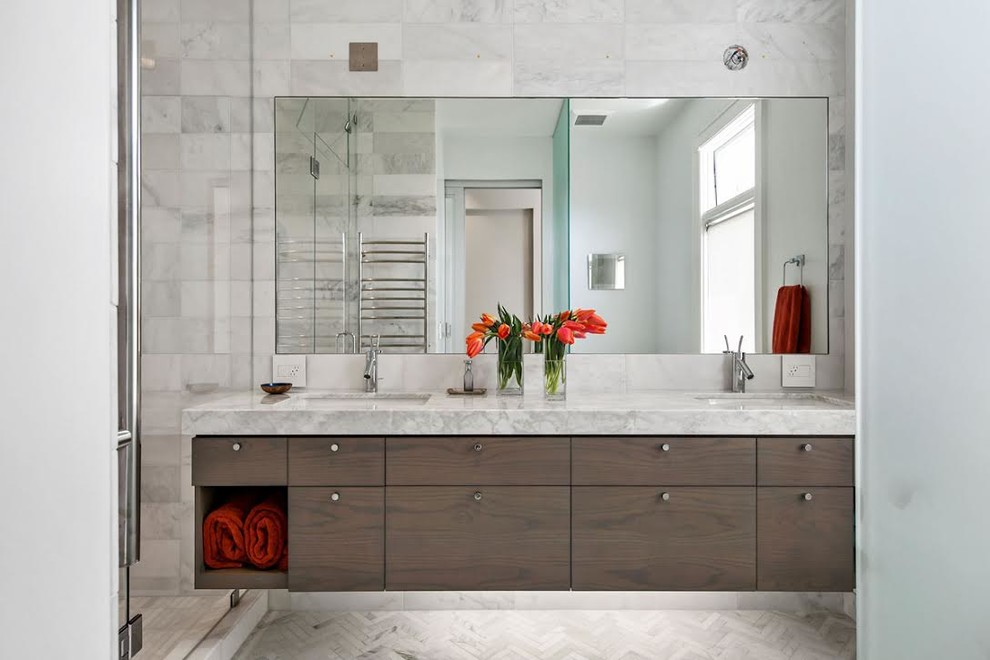 Mid-sized trendy master gray tile, white tile and marble tile marble floor and white floor alcove shower photo in San Francisco with flat-panel cabinets, dark wood cabinets, white walls, an undermount sink, marble countertops and a hinged shower door
