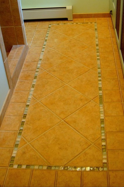 Sand Colored Ceramic Floors Accented With Sea Glass