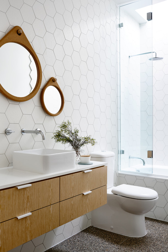 Inspiration for a contemporary 3/4 white tile bathroom remodel in Melbourne with a vessel sink, flat-panel cabinets, light wood cabinets and a two-piece toilet