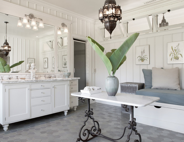 Bathroom - large mediterranean master gray floor bathroom idea in Santa Barbara with furniture-like cabinets, white cabinets, white walls, an undermount sink and marble countertops