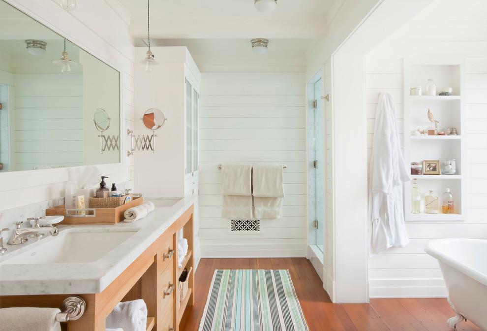 Claw-foot bathtub - coastal claw-foot bathtub idea in Los Angeles with an undermount sink
