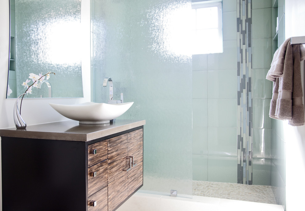 Inspiration for a contemporary bathroom remodel in Los Angeles with concrete countertops