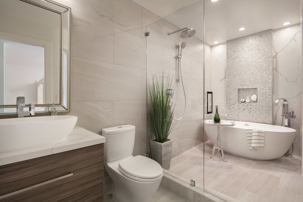 Example of a trendy master beige tile, multicolored tile and mosaic tile beige floor bathroom design in San Francisco with flat-panel cabinets, dark wood cabinets, a one-piece toilet, beige walls, a vessel sink, a hinged shower door and white countertops