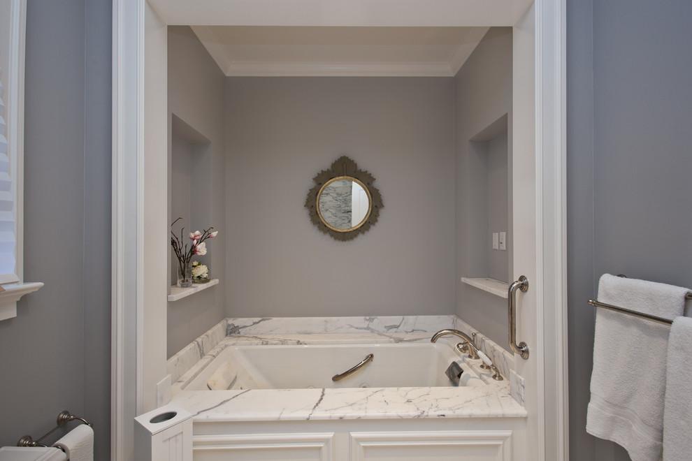 Bathroom - farmhouse bathroom idea in San Francisco with white cabinets and an undermount tub