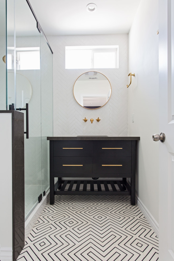 Corner shower - mid-sized contemporary master white tile and subway tile cement tile floor and multicolored floor corner shower idea in Los Angeles with flat-panel cabinets, black cabinets, a wall-mount toilet, white walls, an undermount sink, quartz countertops and a hinged shower door