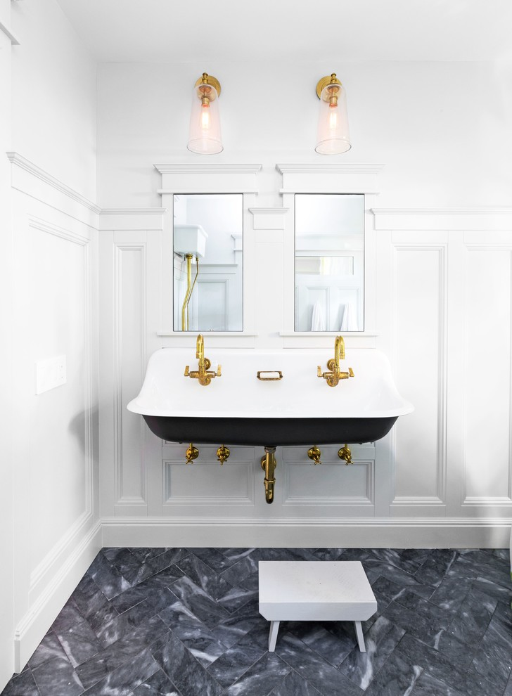 Example of a small classic kids' gray tile and stone tile marble floor claw-foot bathtub design in San Francisco with white cabinets, a wall-mount toilet and white walls