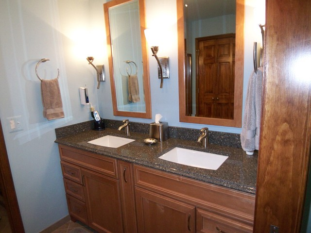 Sconces and custom mirrors to fit the space for Bathroom 94 percent