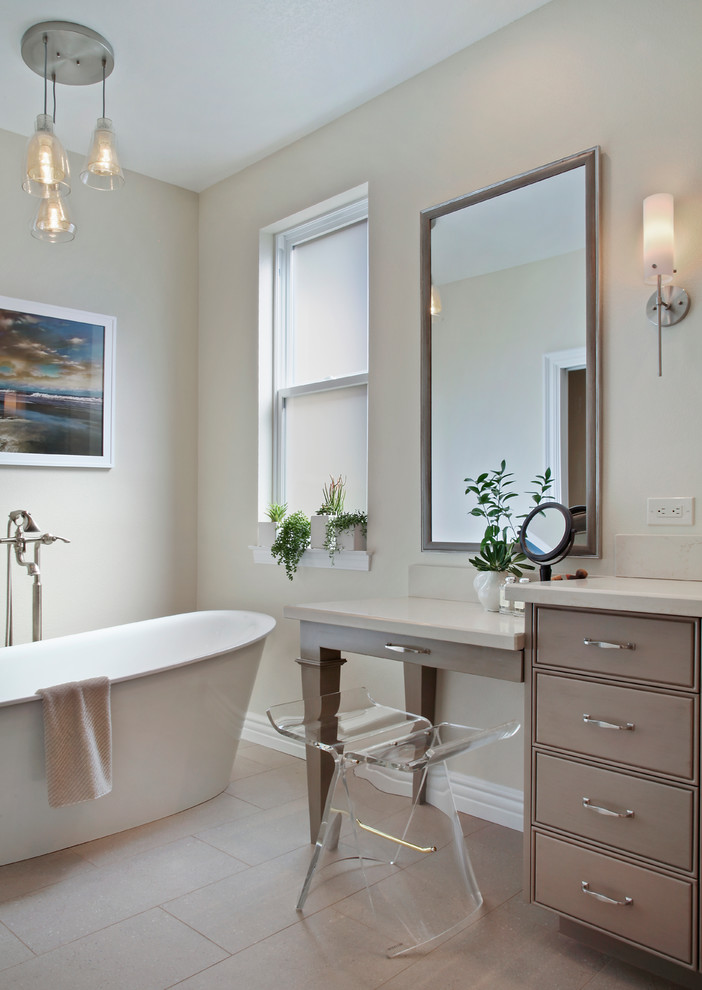 Bathroom - mid-sized transitional master stone tile beige floor and ceramic tile bathroom idea in Orange County with gray cabinets, quartz countertops, a two-piece toilet, beige walls, a hinged shower door, recessed-panel cabinets and a drop-in sink