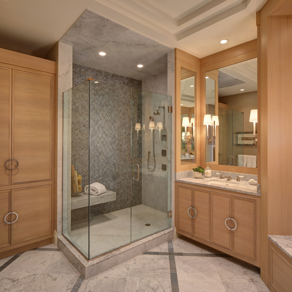 Beach style gray tile corner shower photo in Miami with an undermount sink, flat-panel cabinets and light wood cabinets