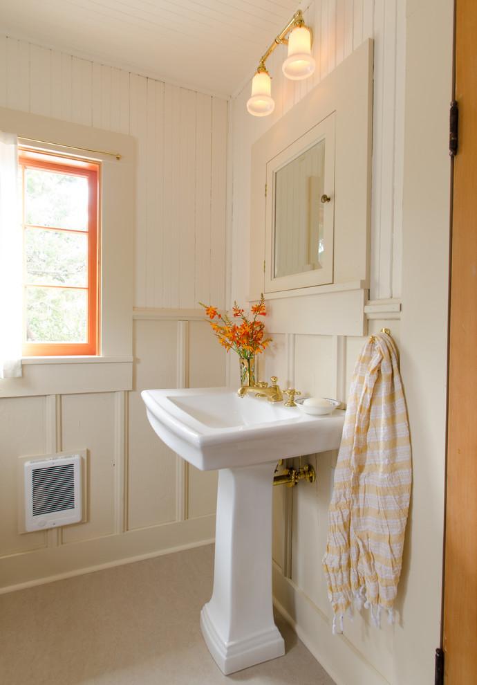 Inspiration for a coastal bathroom remodel in Portland with a pedestal sink