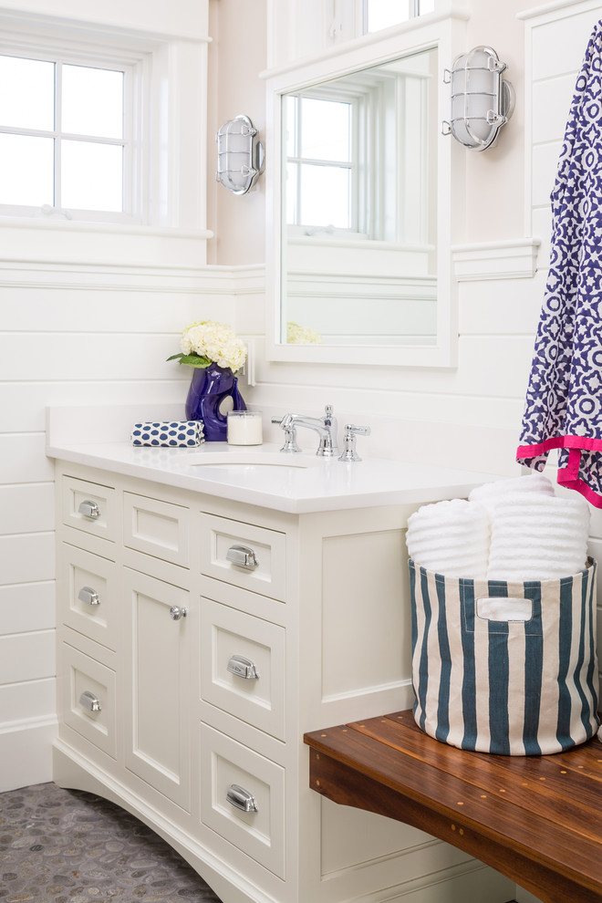 Beach style pebble tile floor and gray floor bathroom photo in Portland Maine with shaker cabinets, white cabinets, beige walls and an undermount sink