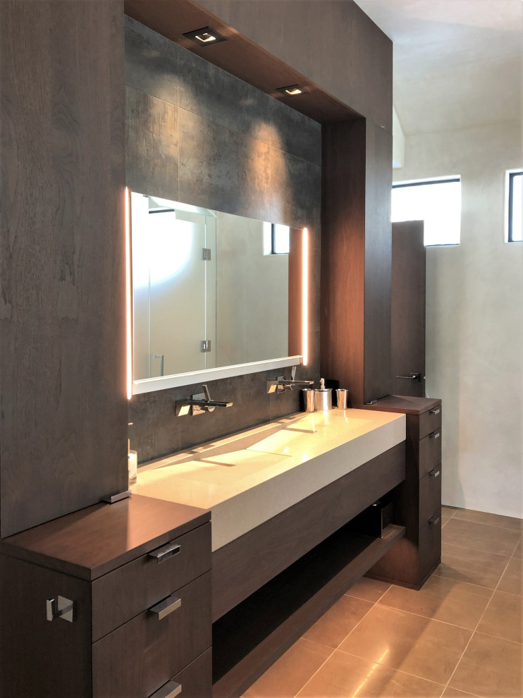 Example of a mid-sized trendy master gray tile brown floor and double-sink bathroom design in Other with flat-panel cabinets, dark wood cabinets, beige walls, a trough sink, a hinged shower door, beige countertops and a built-in vanity
