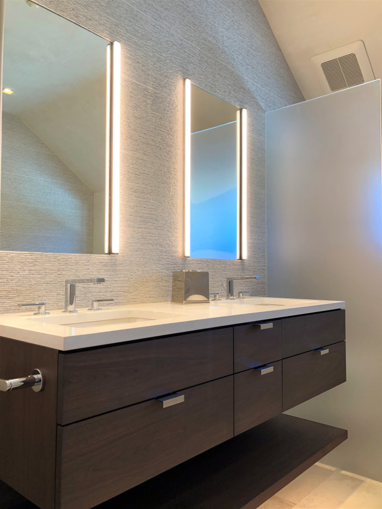 Example of a mid-sized trendy master gray tile beige floor, double-sink and vaulted ceiling bathroom design in Other with flat-panel cabinets, dark wood cabinets, gray walls, an undermount sink, white countertops and a floating vanity