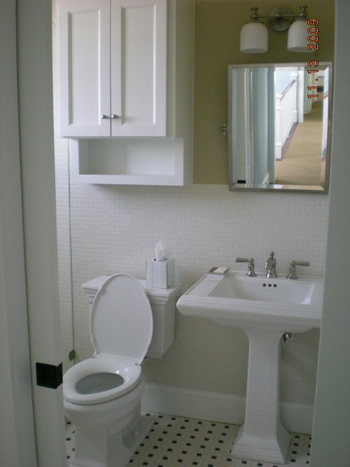 Where can I find the cabinet above the toilet?
