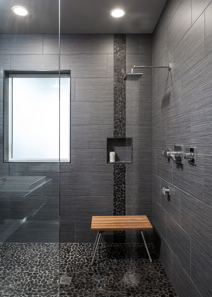 Example of a large trendy master gray tile and porcelain tile pebble tile floor bathroom design in Other with gray walls