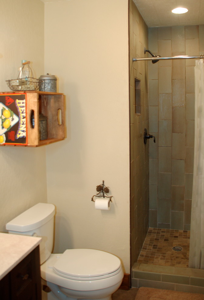 Mid-sized mountain style master corner shower photo in Sacramento with a one-piece toilet, beige walls, raised-panel cabinets, dark wood cabinets and an integrated sink