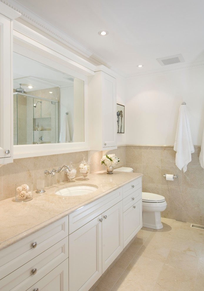 Mid-sized elegant 3/4 beige tile and ceramic tile beige floor bathroom photo in Ottawa with an undermount sink, recessed-panel cabinets, white cabinets, a one-piece toilet, white walls and beige countertops