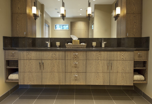 Brown tile bathroom photo in Seattle with an undermount sink, flat-panel  cabinets and