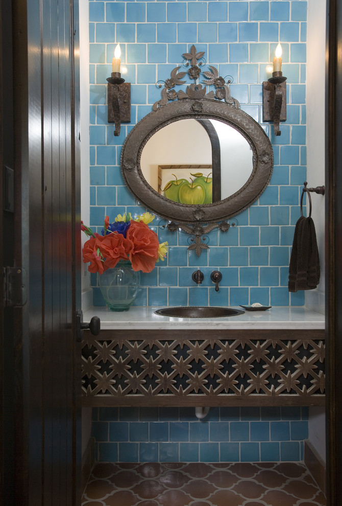 Bathroom - mediterranean blue tile bathroom idea in Houston with a drop-in sink