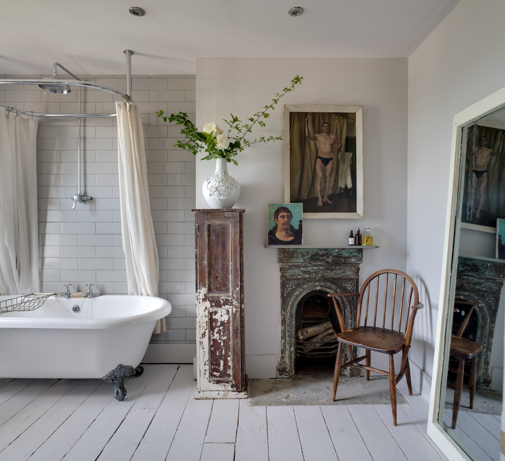 Bathroom - shabby-chic style white tile and subway tile painted wood floor bathroom idea in Kent with white walls