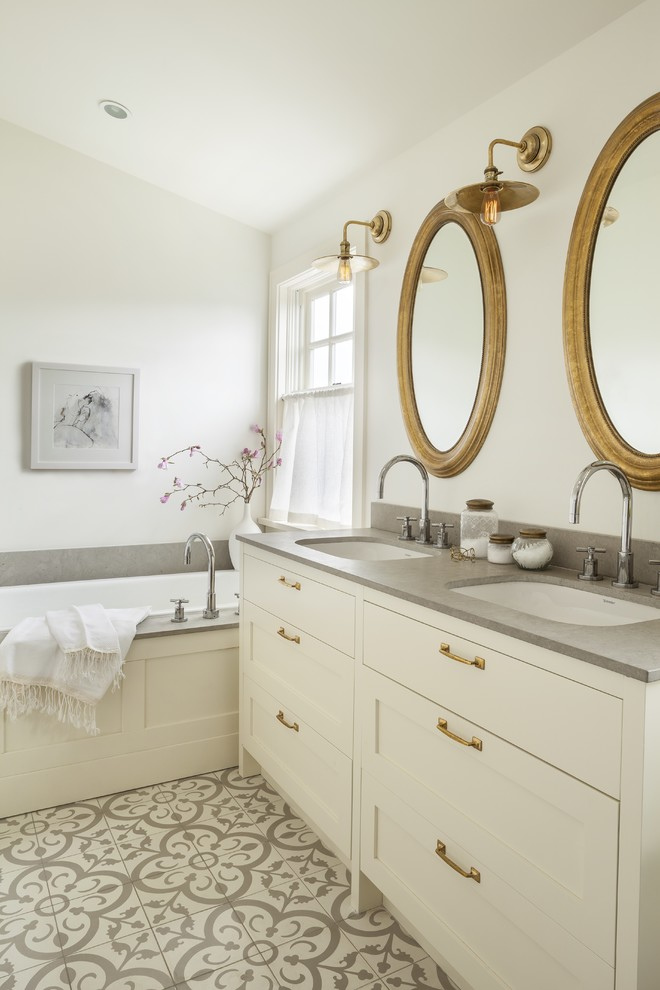 Inspiration for a transitional drop-in bathtub remodel in Vancouver with white cabinets and white walls