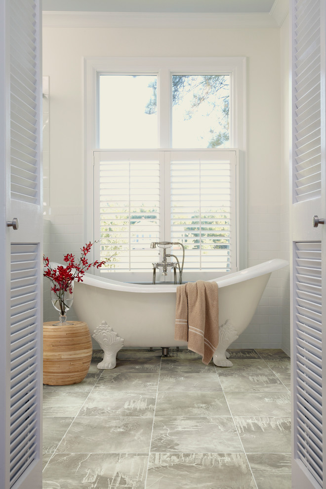 Mid-sized trendy 3/4 gray tile and subway tile ceramic tile and gray floor claw-foot bathtub photo in Orange County with white walls