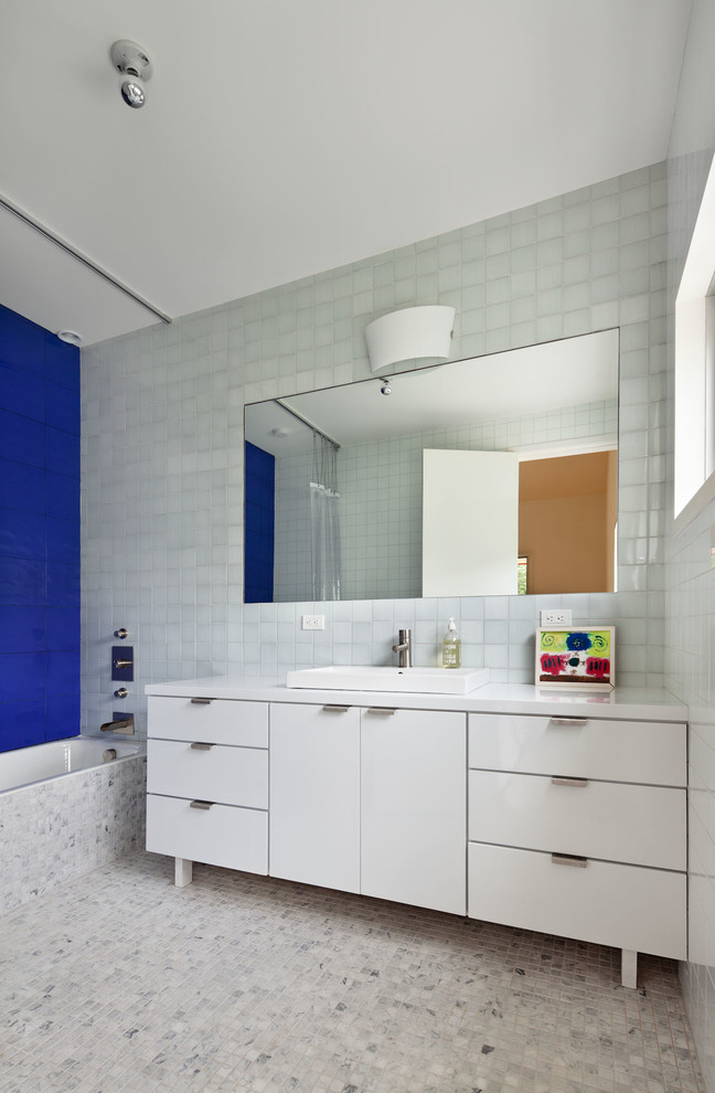 Inspiration for a contemporary blue tile marble floor bathroom remodel in New York with a drop-in sink, flat-panel cabinets and white cabinets