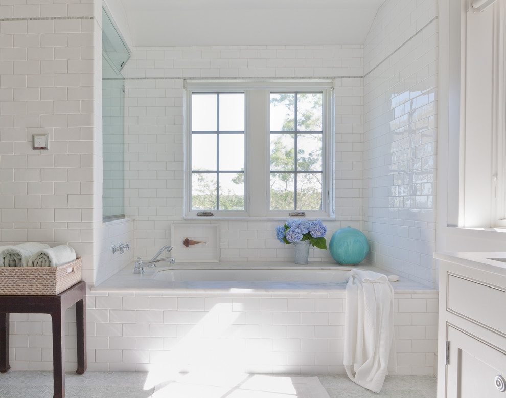 Beach style subway tile bathroom photo in New York with white countertops