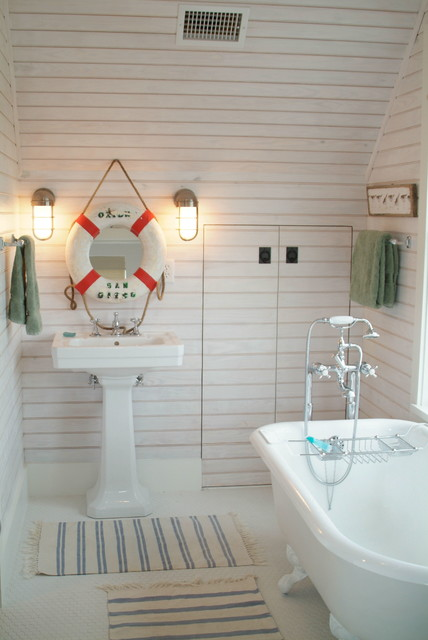 Bathroom - small beach style 3/4 porcelain floor bathroom idea in Miami with flat-panel cabinets, white cabinets, white walls and a pedestal sink