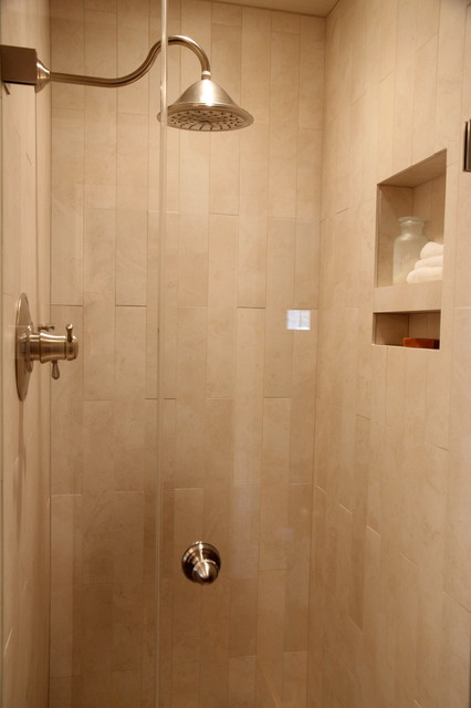 Shower stall with rain shower head and niche for storing ...