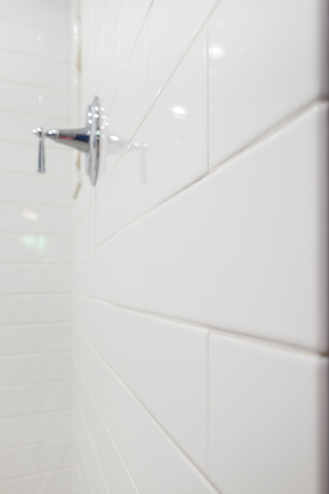 Bathroom - mid-sized traditional master white tile and ceramic tile porcelain tile bathroom idea in Portland with recessed-panel cabinets, white cabinets, a two-piece toilet, blue walls, an undermount sink and quartz countertops