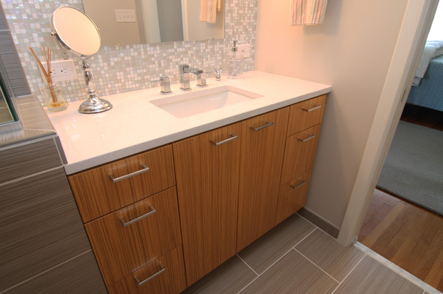Vanity with white countertop and mosaic glass tile back for Mosaic tile vanity top