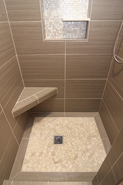 Shower with gray tile bench and beachstone floor modern for Bathroom tiles modern