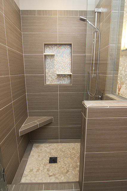 Shower with gray tile bench and beachstone floor for 8x12 bathroom ideas