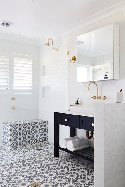 Example of a 3/4 white tile ceramic floor corner shower design in Other with shaker cabinets, black cabinets, white walls, a vessel sink and white countertops
