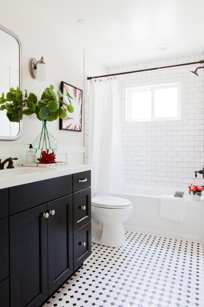 Transitional black and white tile and white tile bathroom photo in Los Angeles with shaker cabinets, black cabinets, white walls and an undermount sink