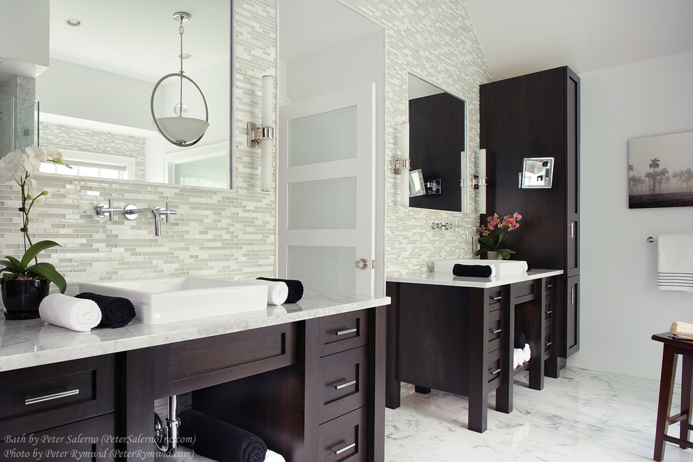 Inspiration for a large transitional master white tile and glass tile marble floor bathroom remodel in New York with a vessel sink, shaker cabinets, dark wood cabinets, marble countertops, a two-piece toilet and white walls