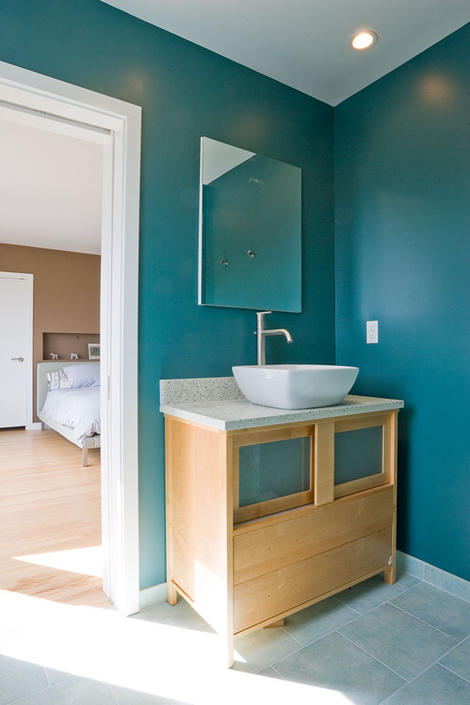Inspiration for a contemporary master bathroom remodel in San Francisco with granite countertops, a vessel sink, glass-front cabinets, light wood cabinets and blue walls