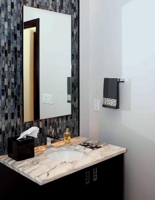 Powder room with glass tiles. modern-bathroom