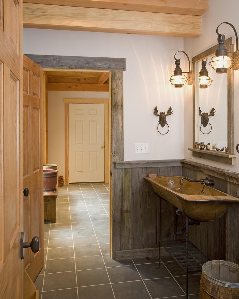 Bathroom - rustic bathroom idea in Burlington with a trough sink and open cabinets