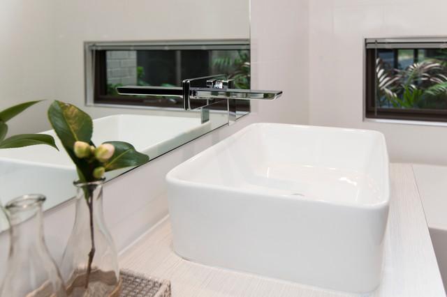 Sleek Country Retreat contemporary-bathroom