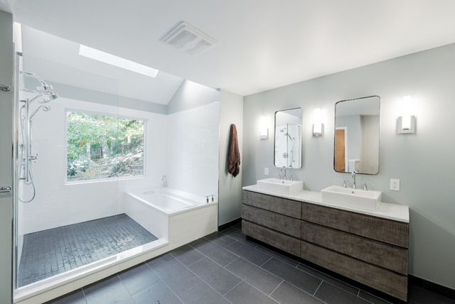 Bathroom - large contemporary master white tile and subway tile ceramic floor and gray floor bathroom idea in New York with furniture-like cabinets, a two-piece toilet, gray walls, a vessel sink, distressed cabinets and solid surface countertops