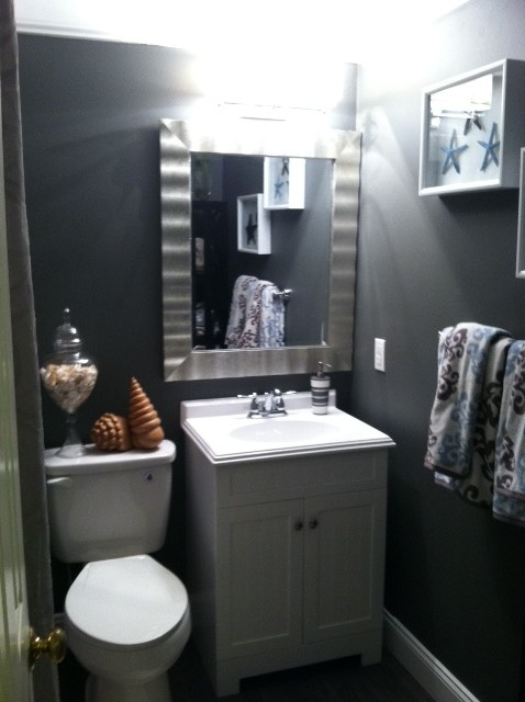 Example of an island style bathroom design in Orange County