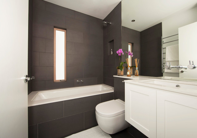 Mid-sized trendy black tile and ceramic tile porcelain floor bathroom photo  in Sydney with