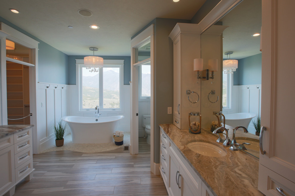 Large transitional master bathroom photo in Salt Lake City with an undermount sink, shaker cabinets, white cabinets and blue walls