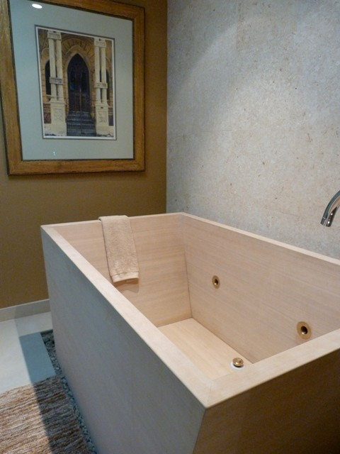 Soaking Tub Is Inset In Pebble Recess With Limestone Walls