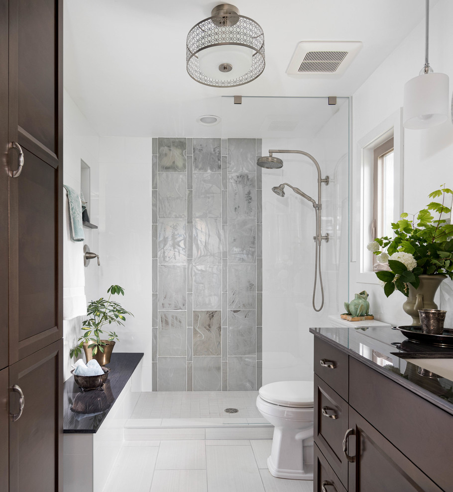 Example of a mid-sized transitional master white tile and glass tile porcelain tile and gray floor bathroom design in Seattle with dark wood cabinets, white walls, an undermount sink and gray countertops