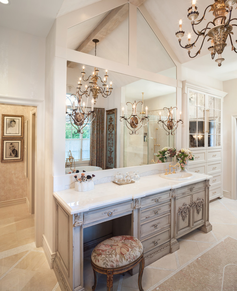Large elegant master beige tile and stone tile marble floor bathroom photo in Houston with a drop-in sink, furniture-like cabinets, beige cabinets, marble countertops and white walls