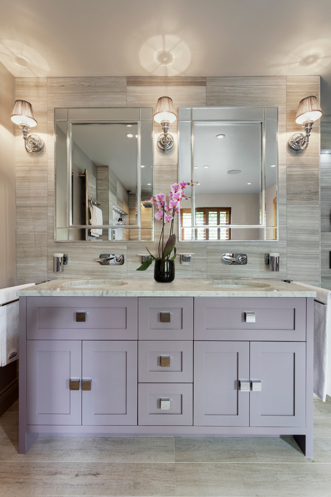 Example of a large transitional master gray tile and stone slab limestone floor bathroom design in Sussex with flat-panel cabinets, light wood cabinets, gray walls, marble countertops and an undermount sink