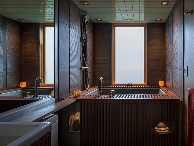 Example of a mid-sized minimalist brown tile and porcelain tile porcelain floor and green floor bathroom design in Seattle with furniture-like cabinets, dark wood cabinets, a one-piece toilet, gray walls, a drop-in sink and wood countertops